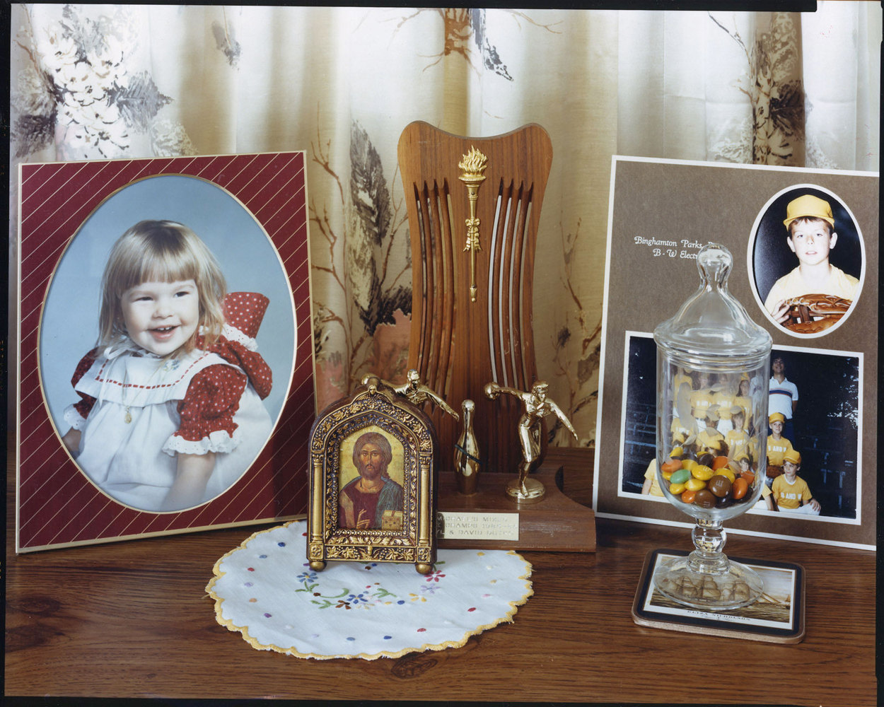 Framed children's portraits, trophy, religious picture, with M&M's