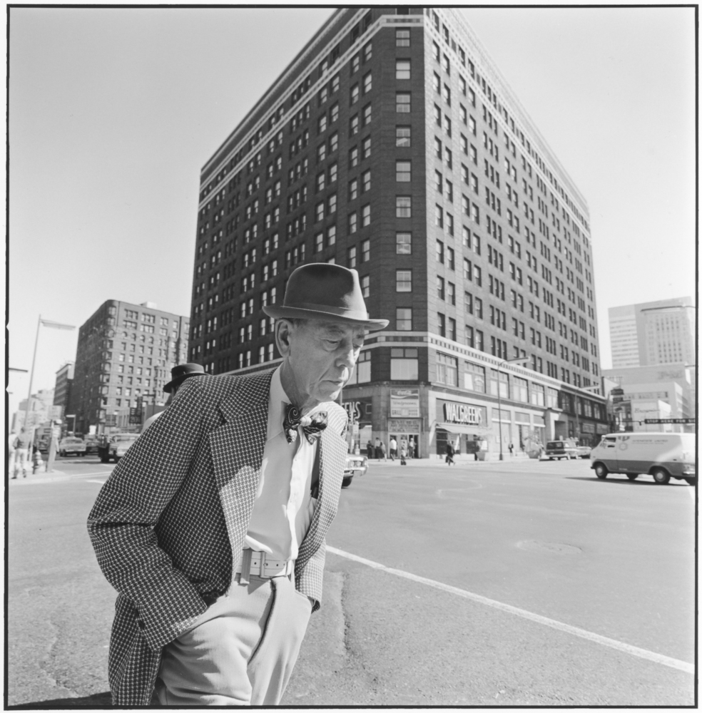 Man with a bow tie, 6th Street & Hennepin Ave, Minneapolis, Minnesota, 1975